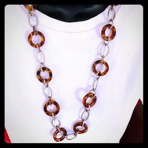 Long necklace of leopard rings & silver tone chain